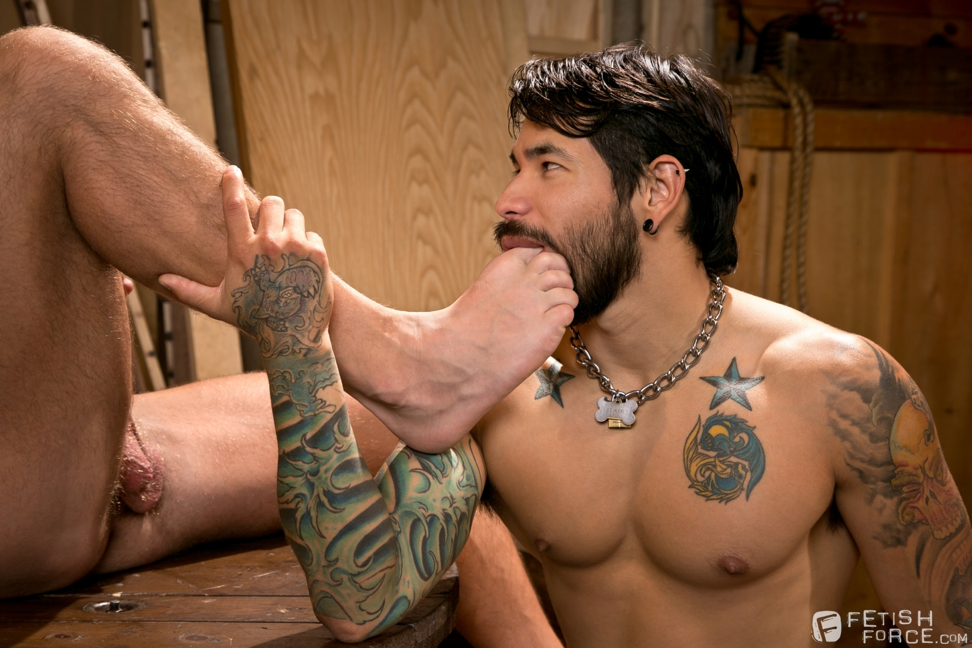 Men jerking each other off